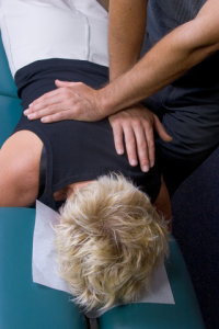 Woman Chiropractic adjustment to back